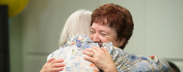 Care Manager Hugging Client